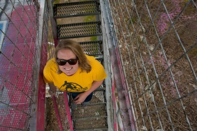 Michelle climbing the Woodstock Fire Tower on top of Massanutten Mountain in the George Washington NF