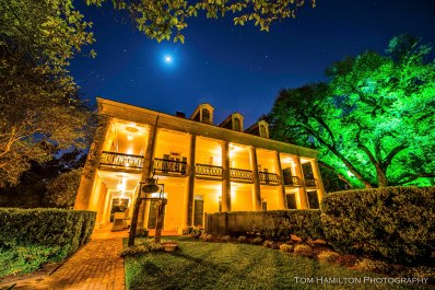 A crescent moon sets over Oak Alley Plantation