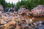 A waterfall cascades into the Atlantic Ocean