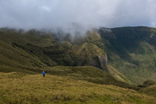 Michelle hikes around the rim of the massive volcanic caldera on the Island of Faial.