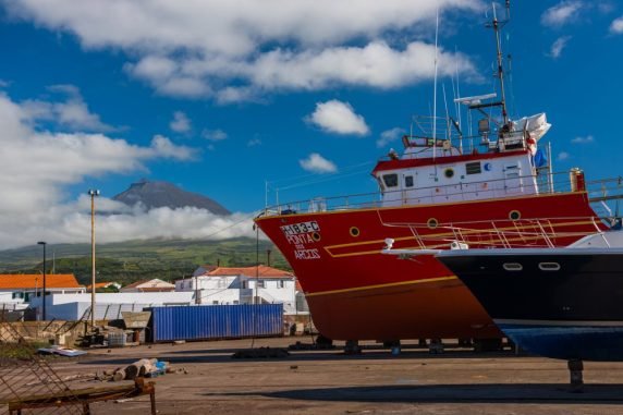 Fishing boats slumber beneath Pico, Portugal's highest mountain.