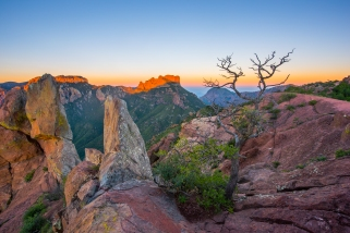 Alpenglow illuminates the Chisos Mountains, as seen from the Lost Mine Trail in Big Bend National Park.
